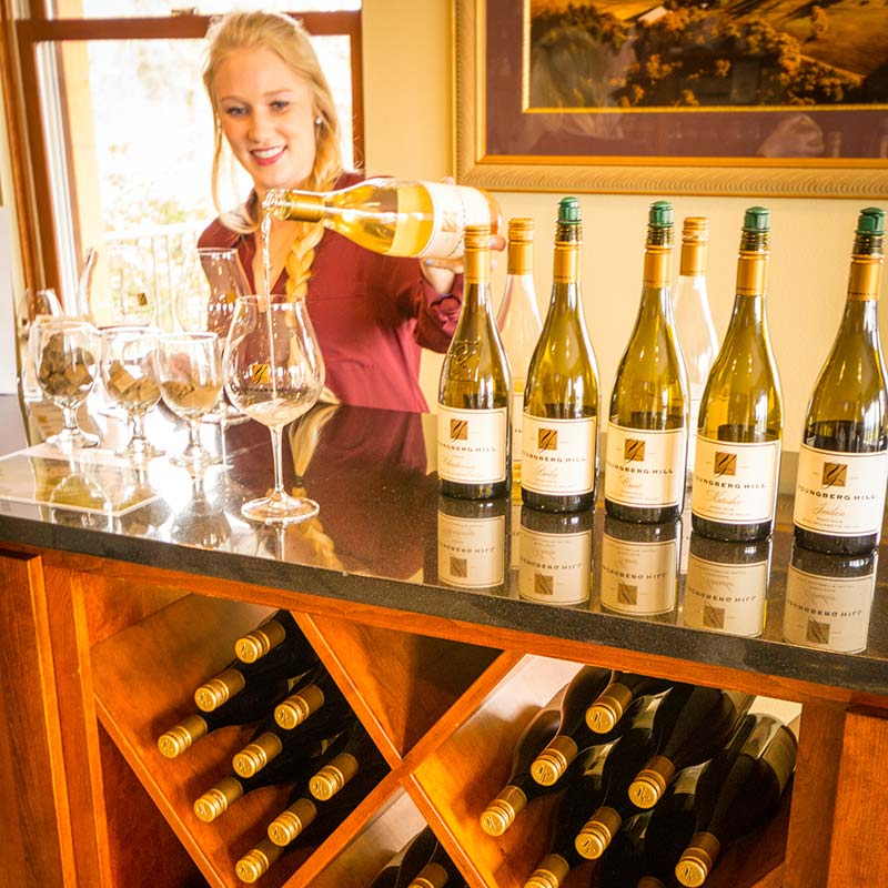 Hostess Pouring White Wine for a Wine Tasting Tour