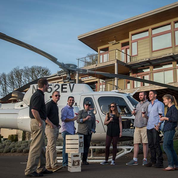 Helicopter Wine Tour Group Drinking Wine in front of Helicopter