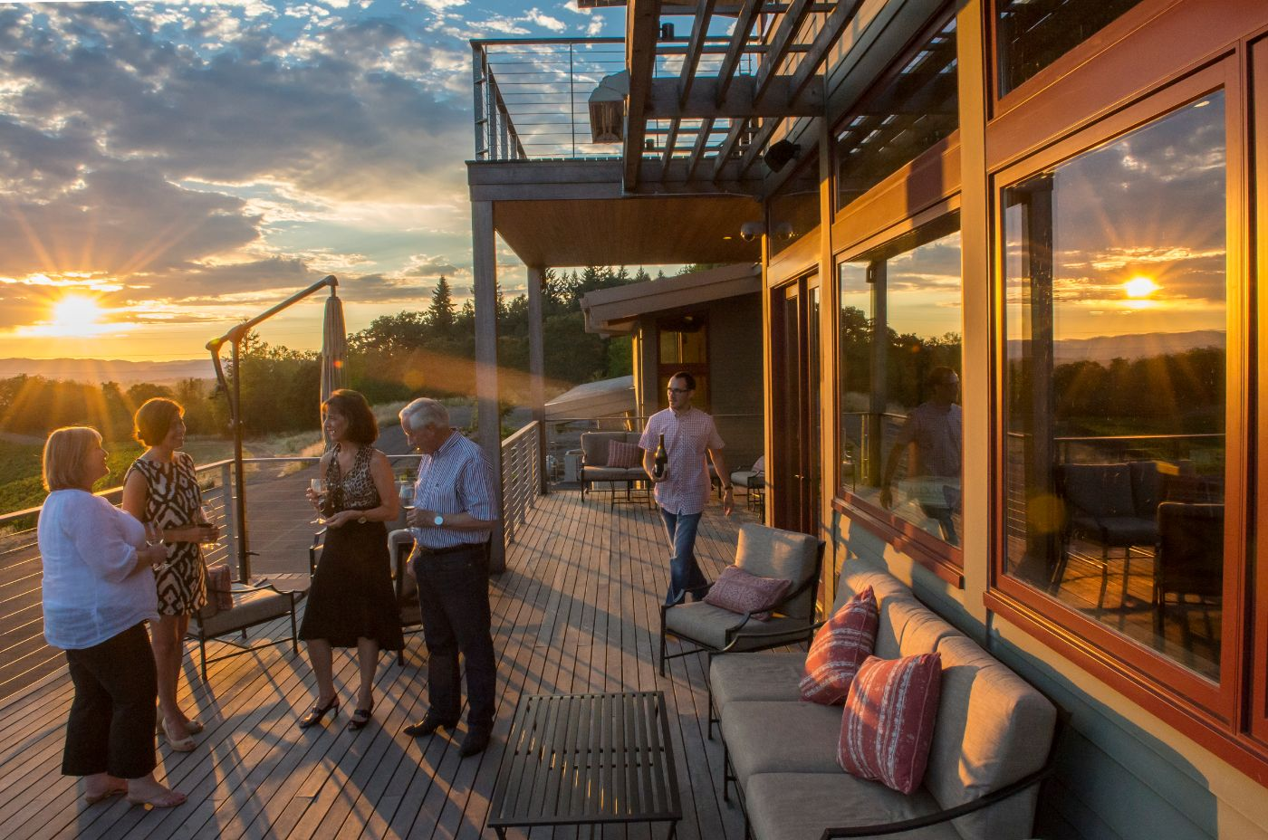 Tour Devine guests wine tasting at Alexana Winery near Dundee Oregon at sunset