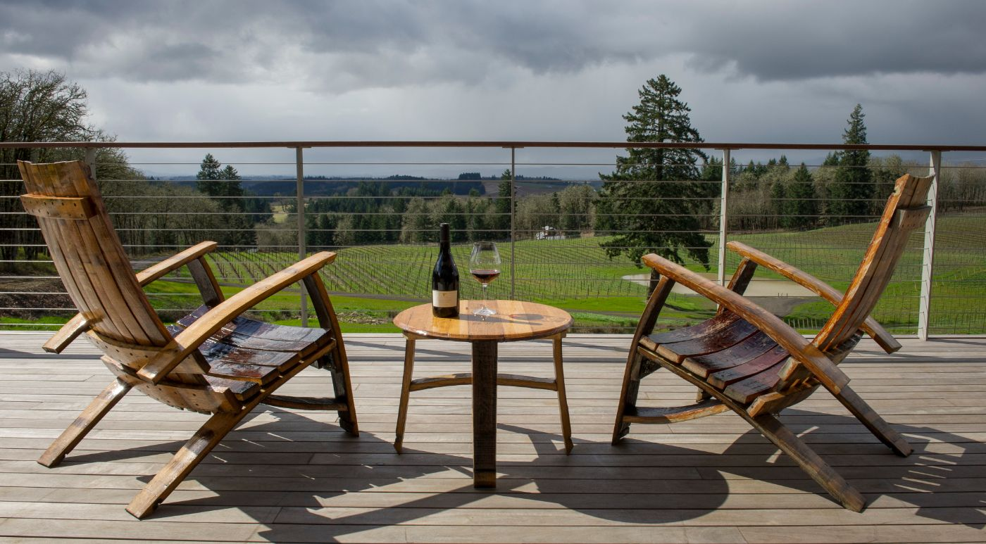 Chairs and bottle of wine on the balcony of Alexana Winery near Dundee Oregon