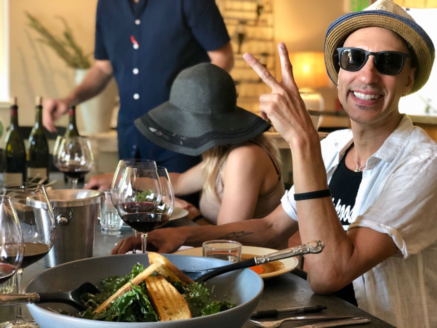 Guests enjoying lunch and wine on tasting trip