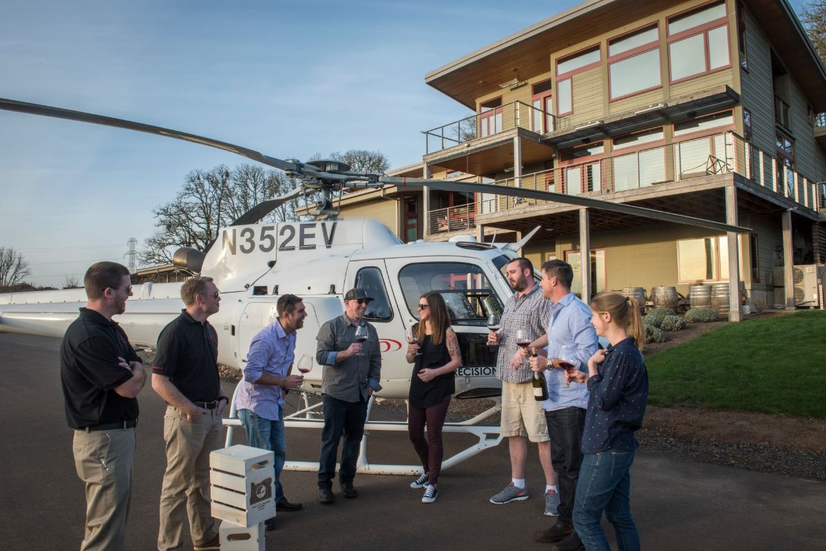 Wine tasting group standing in front of helicopter on Tour DeVine trip