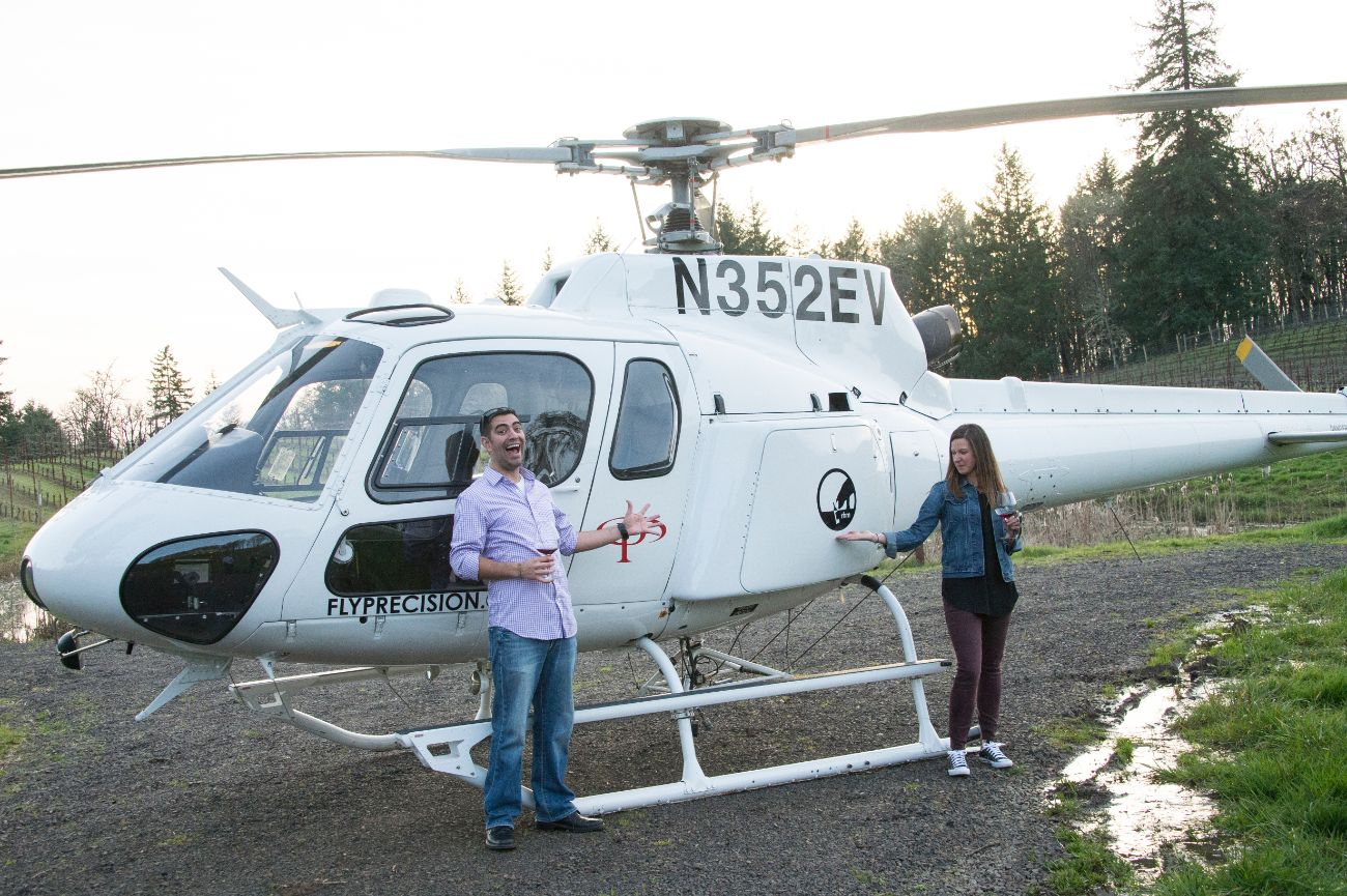 Wine tasters next to helicopter on Tour DeVine trip