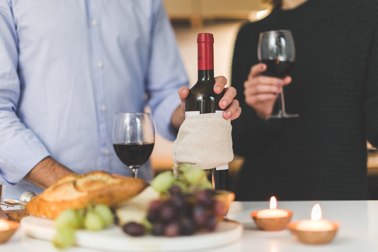 Couple dressed business-casually and drinking wine
