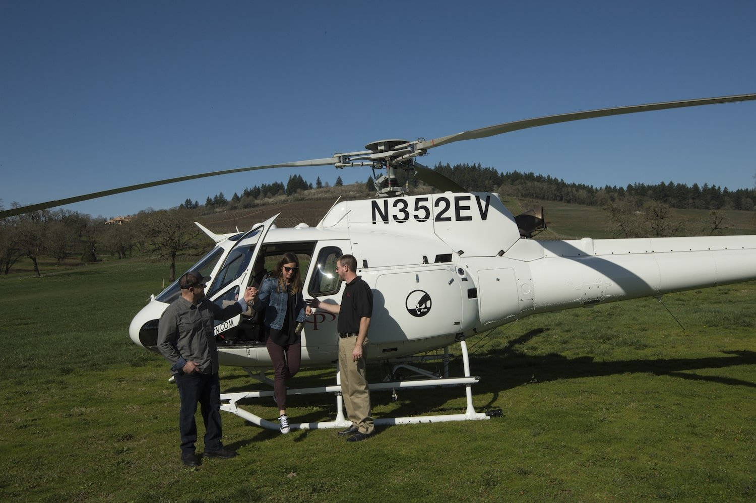 Wine tasting group with Tour DeVine disembarking from helicopter