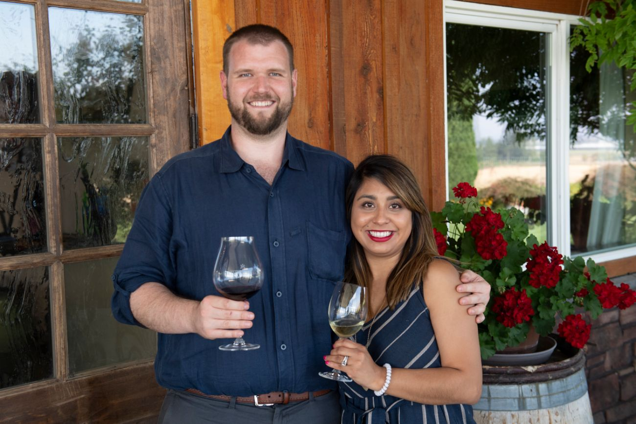 Smiling couple at wine tasting in Oregon
